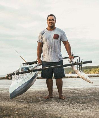 Hopeful man holding his fishing kayak