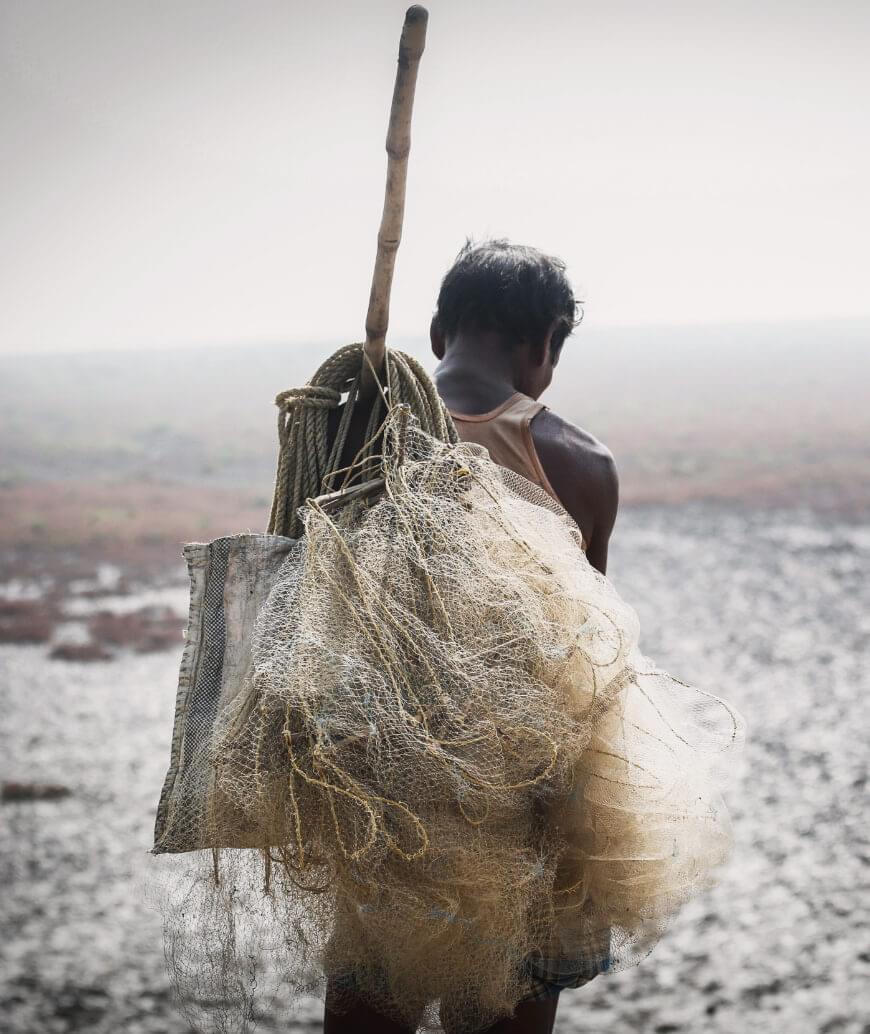 Hard working man holding his fishing gear
